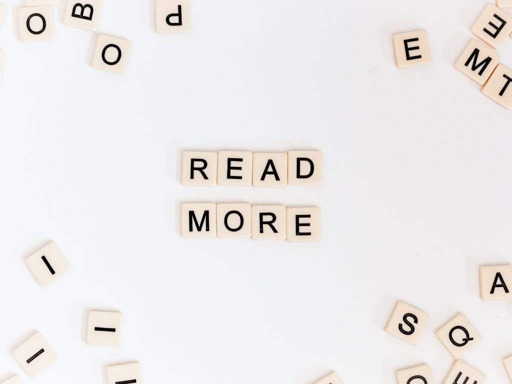 Scrabble tiles spell out read more, a good tip for self editing fiction